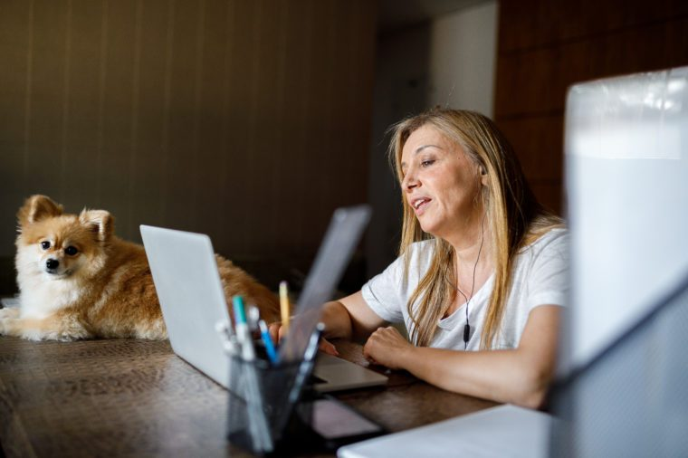 Woman in meeting by video conference