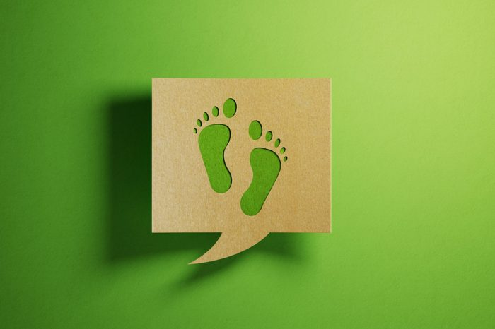 Chat Bubble Made of Recycled Paper On Green Background