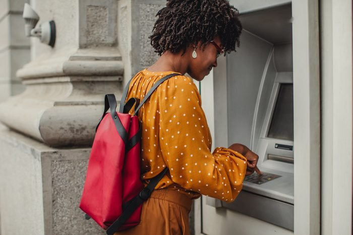 Woman Making A Cash Withdrawal At An ATM