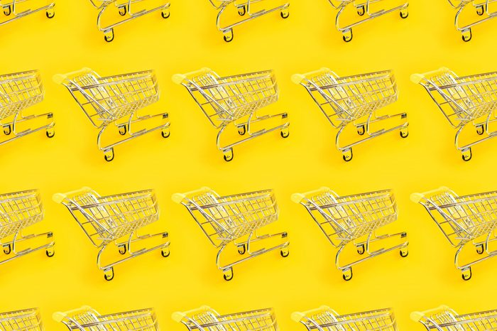 Shopping trolley on a yellow background. Modern trendy design for any purposes. Online shopping