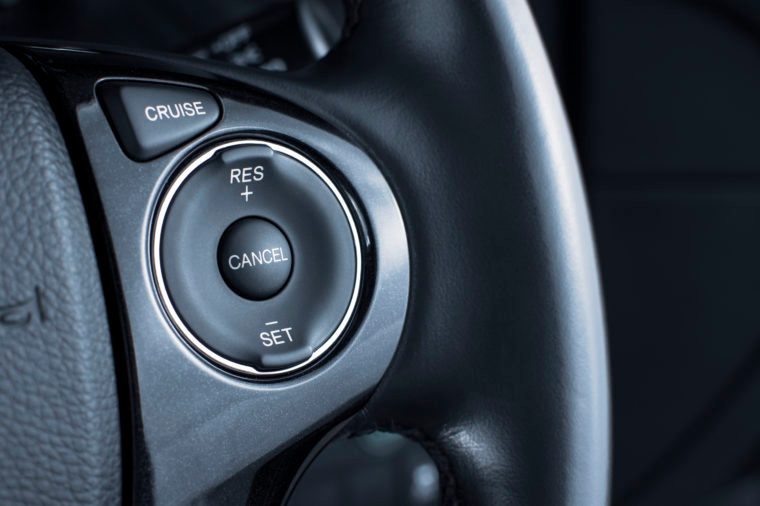 Cruise control button switch on steering wheel.