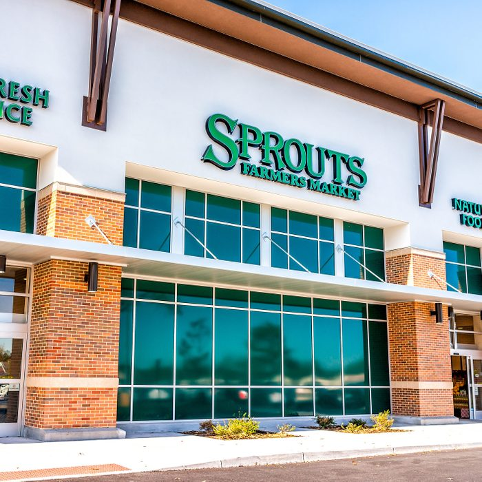 Exterior of Sprouts Farmers Market store with farm fresh produce sign on street