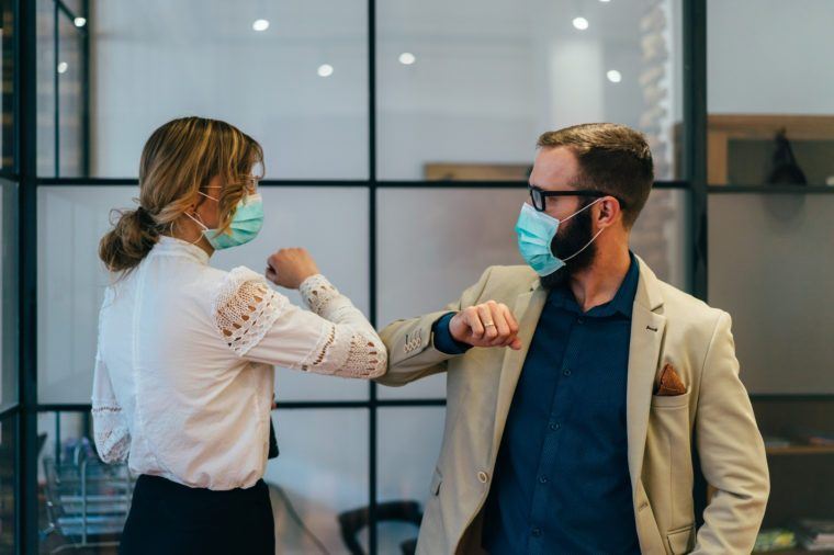 Business people greeting during COVID-19 pandemic