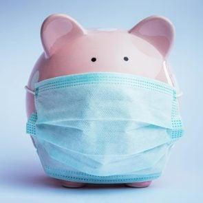 piggy bank with a surgical mask. coronavirus finances concept.