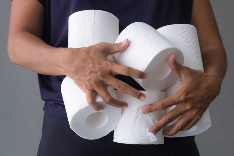 Female shopper hoarding toilet paper