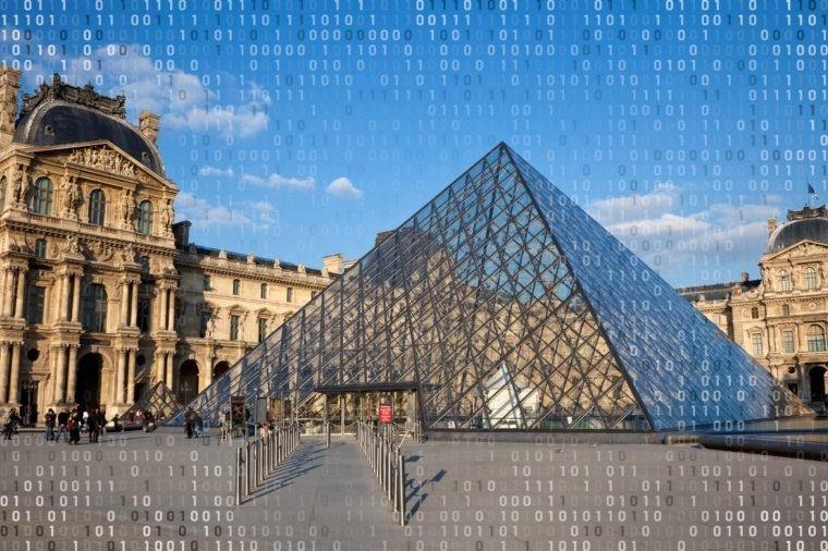 the louvre exterior with computer code overlay