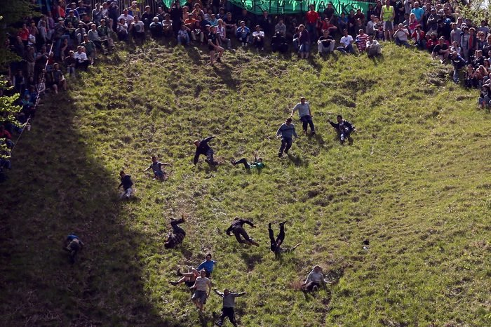 Cooper's Hill Hosts The Annual Cheese Rolling And Wake
