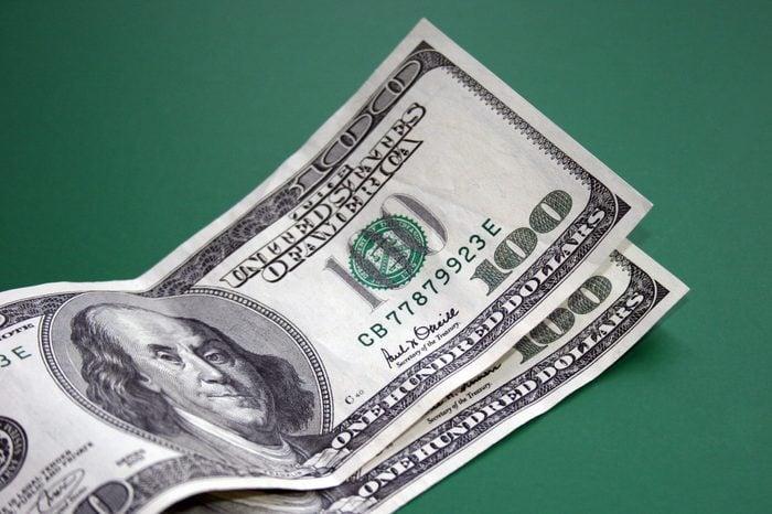 Two Hundred Dollar Bills on Green