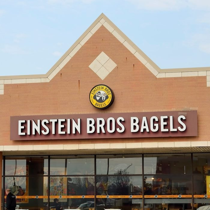 """""""Troy, Michigan, USA - March 6, 2012: The Einstein Bros. Bagels location off John R Road in Troy, Michigan with guests enjoying thir meal and pedestrian passing by. Founded in Colorado, Einstein Bros. Bagels is a chain of bagel and coffee shops with almost 600 locations in the US."""""""