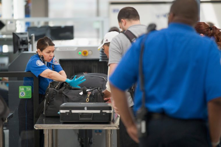 Travelers are screened by Transportation Security Administration (TSA) workers at a security check point at O'Hare Airport on June 2, 2015 in Chicago, Illinois.