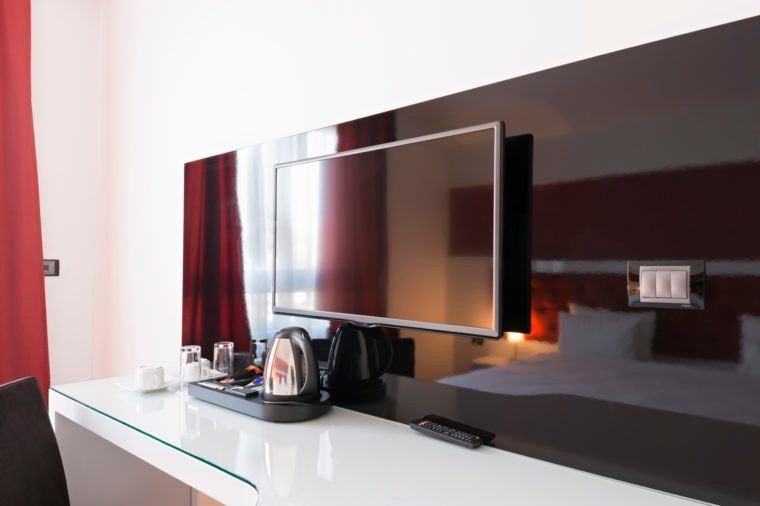 Desk and tv in modern hotel room