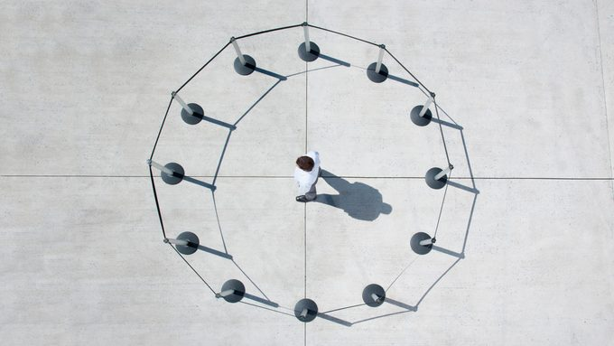 overhead view of a man within a circle of cordon posts