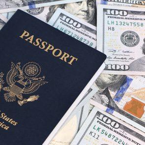 cancelled trip refund US passport and hundred dollar bills
