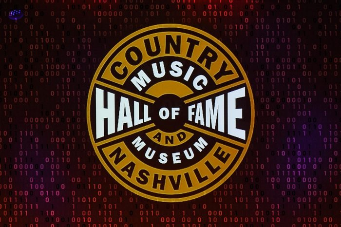 nashville country music hall of fame and museum logo with computer code overlay