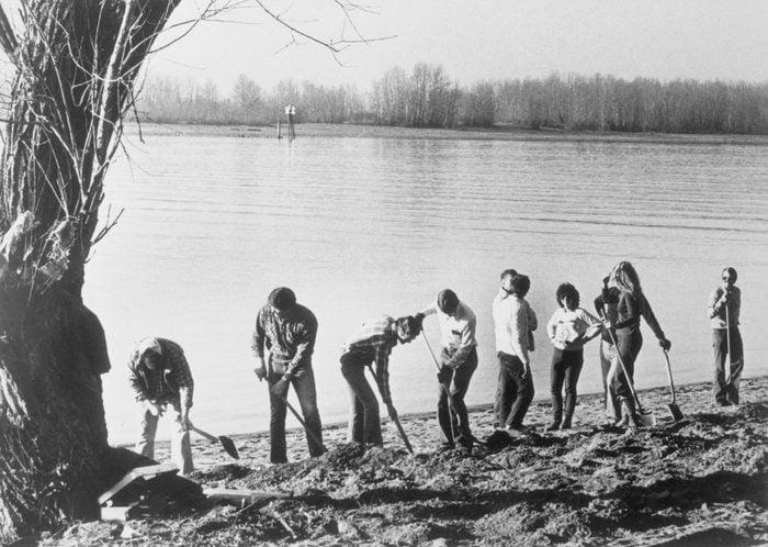 FBI Agents Digging Alongside River