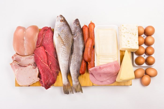 Group of important proteins, meats, fish, dairy, eggs, white meat on a white background, Shot from above