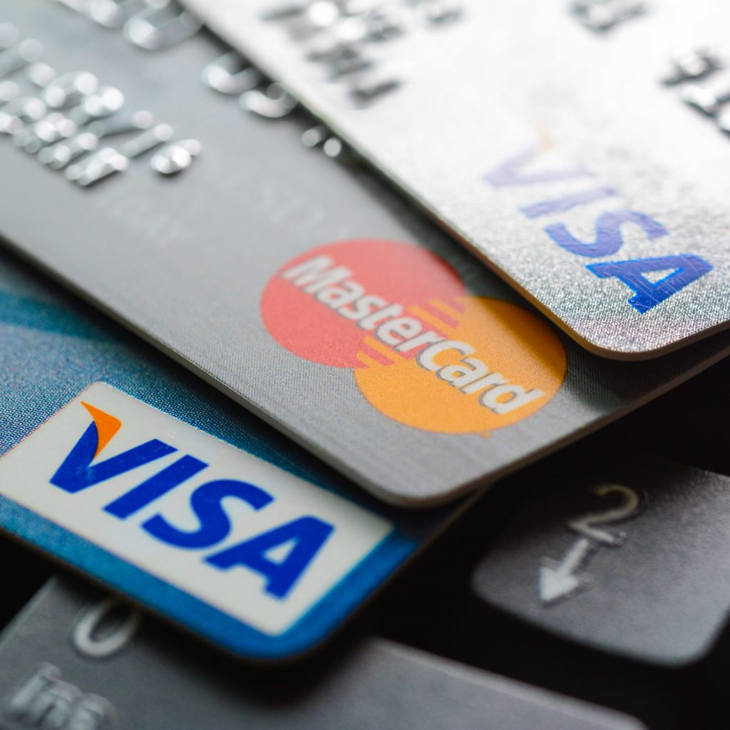 Group of credit cards on computer keyboard