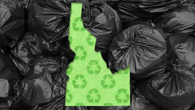 shape of idaho with recycle symbol pattern against garbage bags background