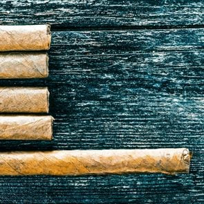 Group of cigars on the wood