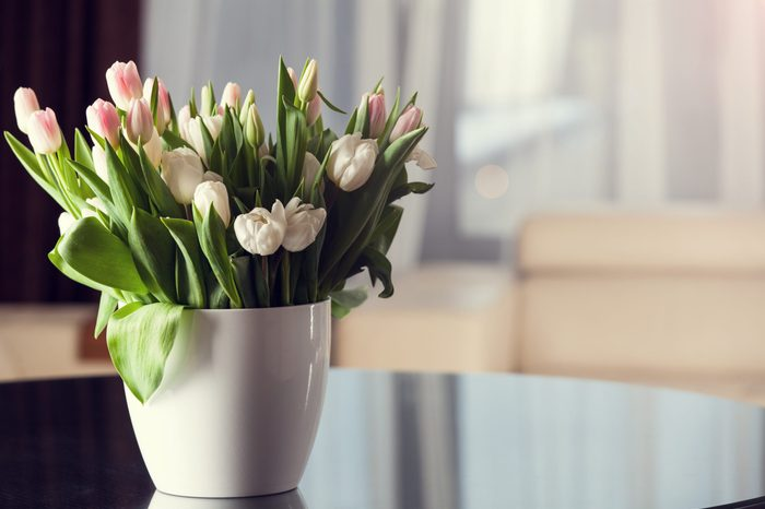 Fresh pink tulip flowers bouquet on the table.