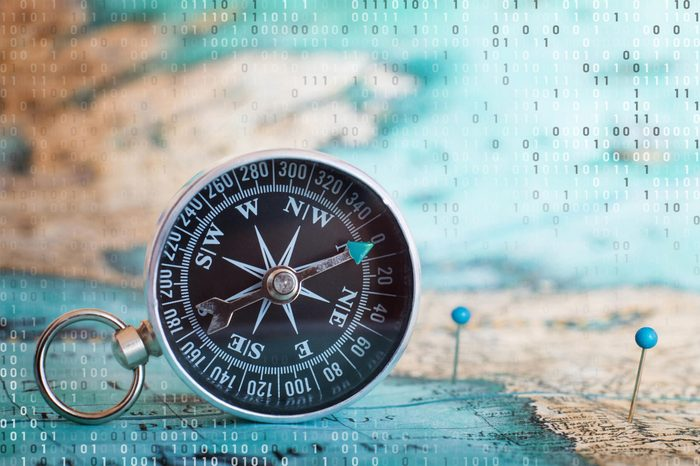 compass and map with computer code overlay