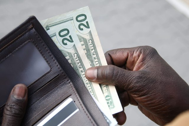 African-American businessman gets money from the wallet