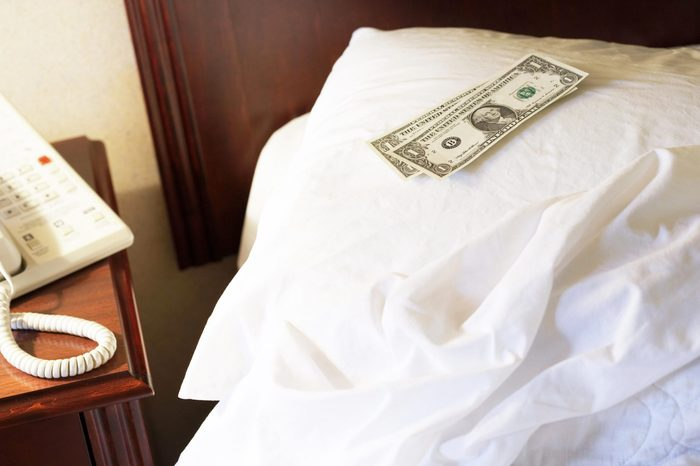 money on a hotel bed