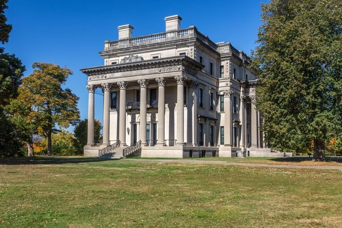 Vanderbilt Mansion National Historic Site with Trees in Fall Colors (Foliage) and Vivid Blue Sky, Hyde Park, New York.