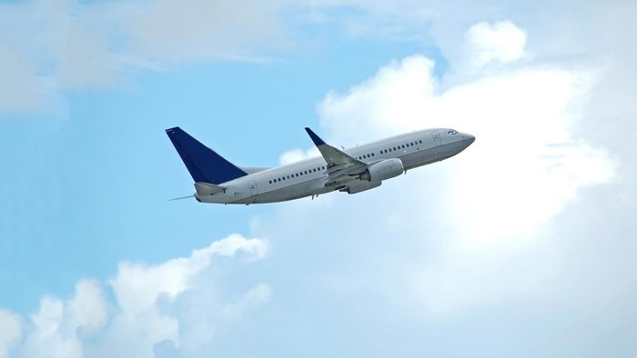 airplane with clouds background.