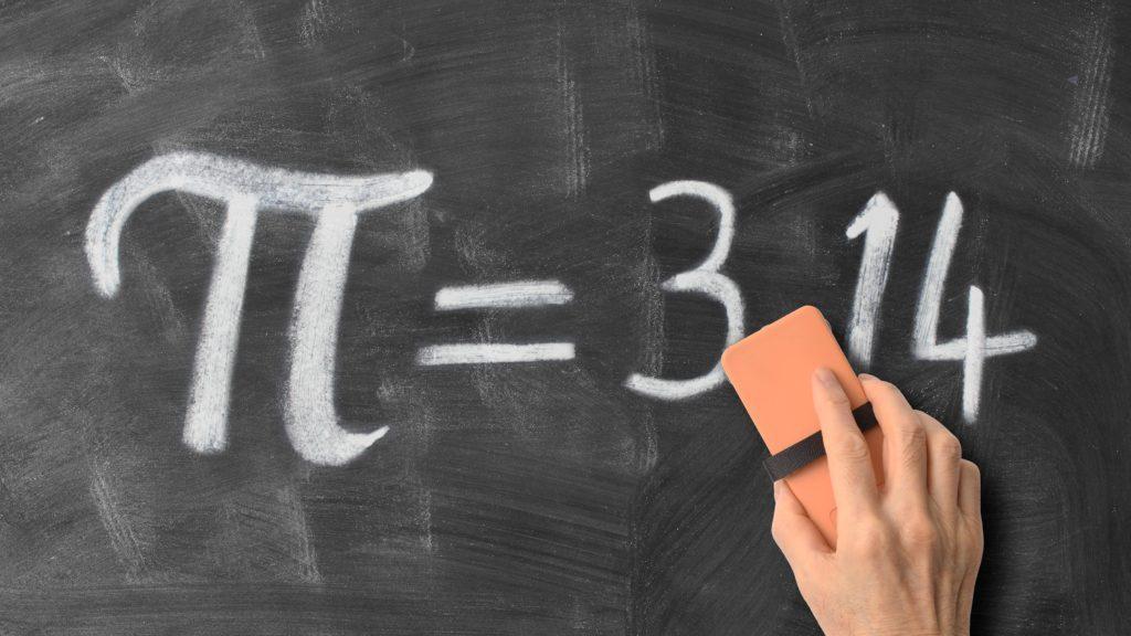 hand erasing pi on a chalkboard