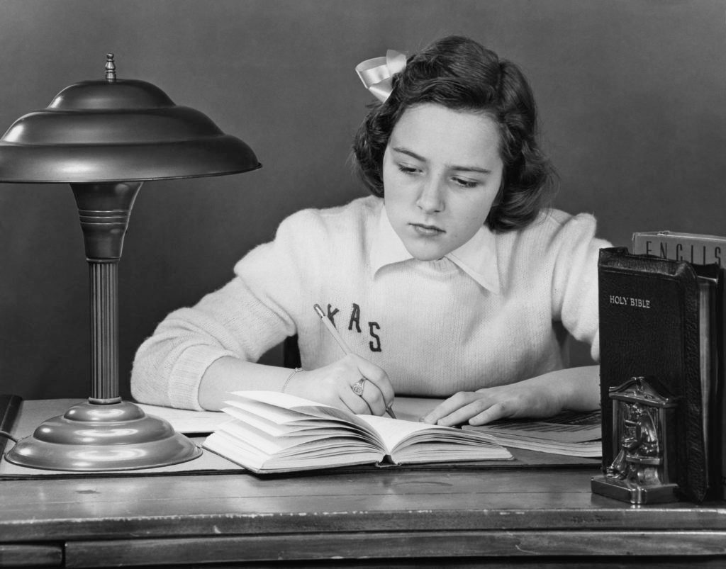 girl doing homework circa 1947