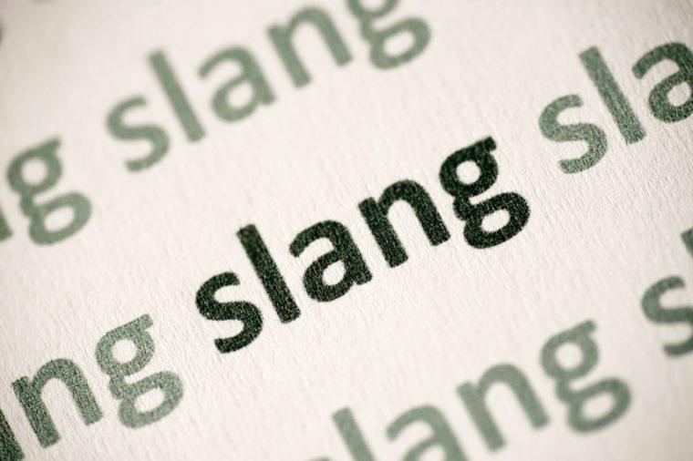 word slang printed on paper macro
