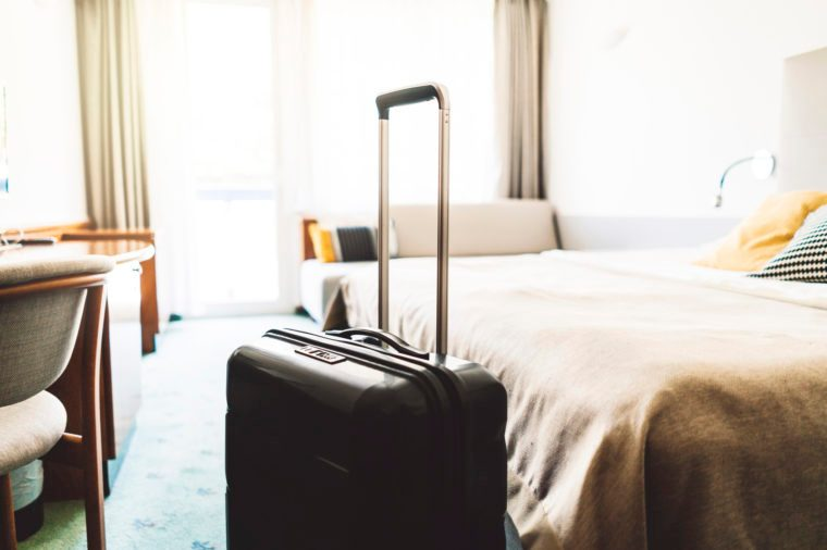 Suitcase in a large empty hotel room