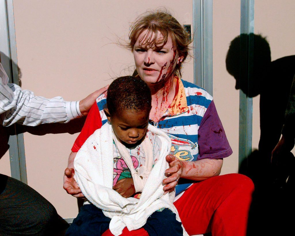 a child being cared for in the aftermath