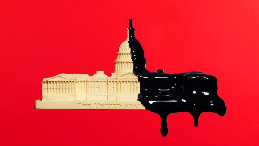 capitol building dripping with black paint on red background