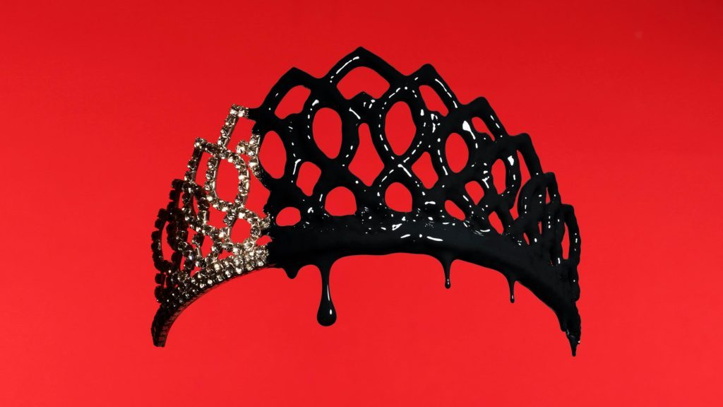pageant tiara dripping with black paint on red background