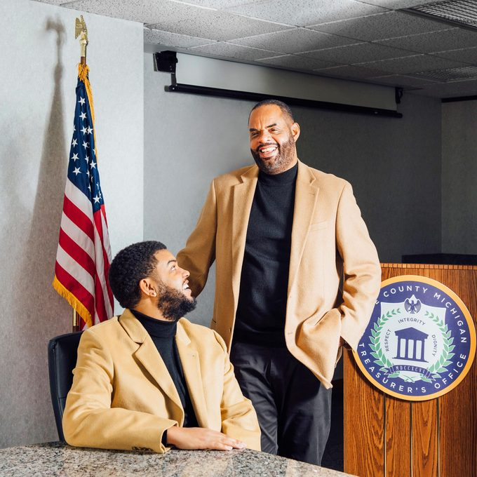 Michael Evans and his son in the treasury office