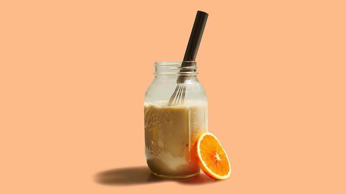 creamy fennel dressing in a mason jar on orange background