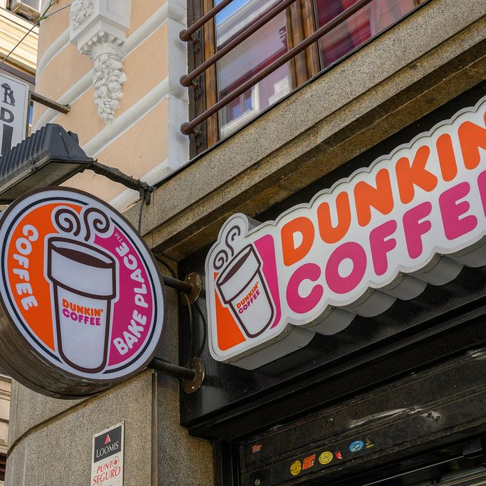 MADRID, SPAIN - MAY 04: Street sign outside Dunkin' Coffee shop near Puerta del Sol square on May 04, 2019 in Madrid, Spain. Dunkin', formerly Dunkin' Donuts, is an American multinational coffee company and quick service restaurant. (Photo by Horacio Villalobos - Corbis/Corbis via Getty Images)
