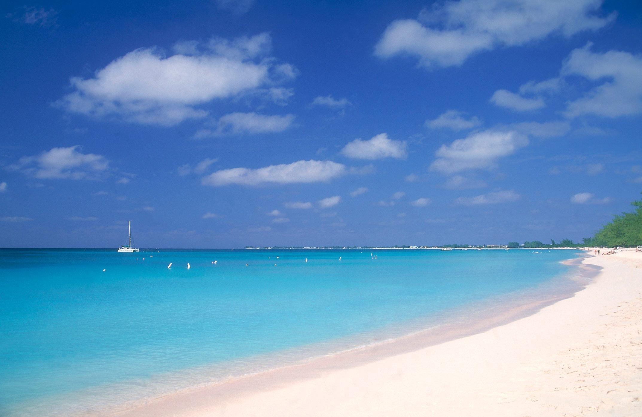 White sand beach with with blue water and skies, Seven Mile Beach, Grand Cayman Island