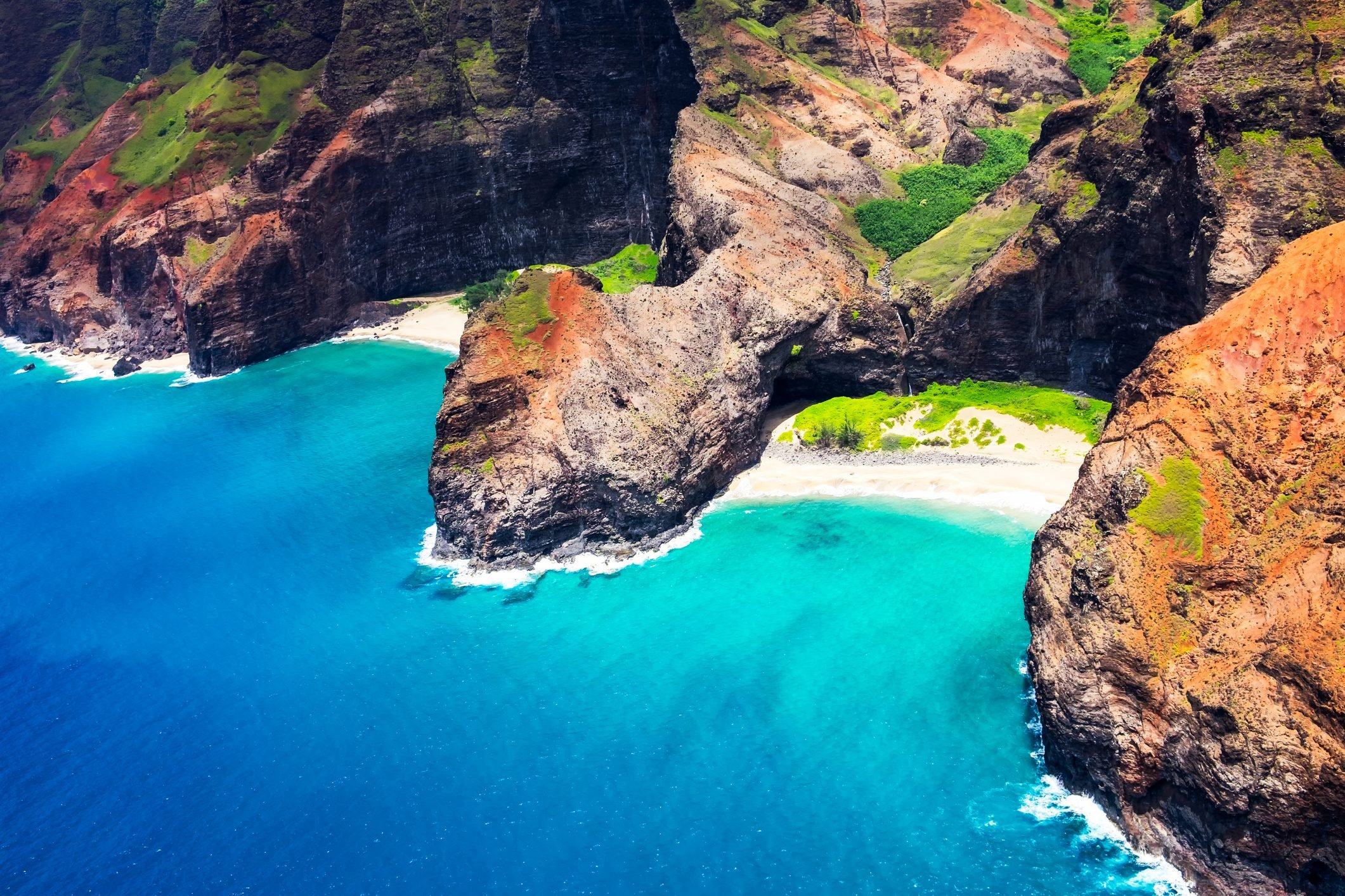 Aerial landscape view of Honopu Arch at Na Pali coastline