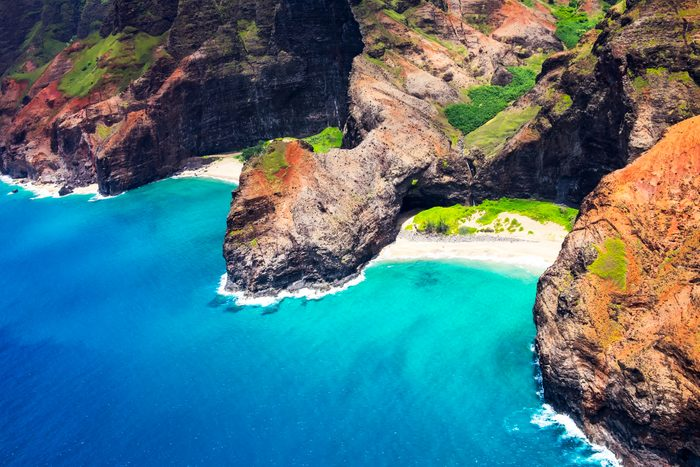 Aerial landscape view of Honopu Arch at Na Pali coastline