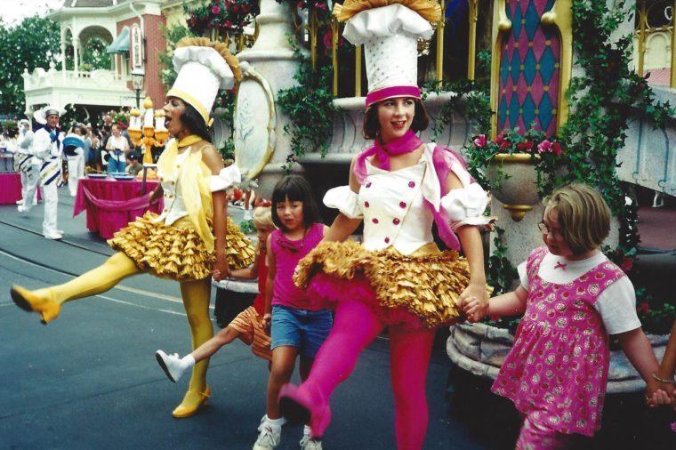 kids in parade magic kindgom disney 90s