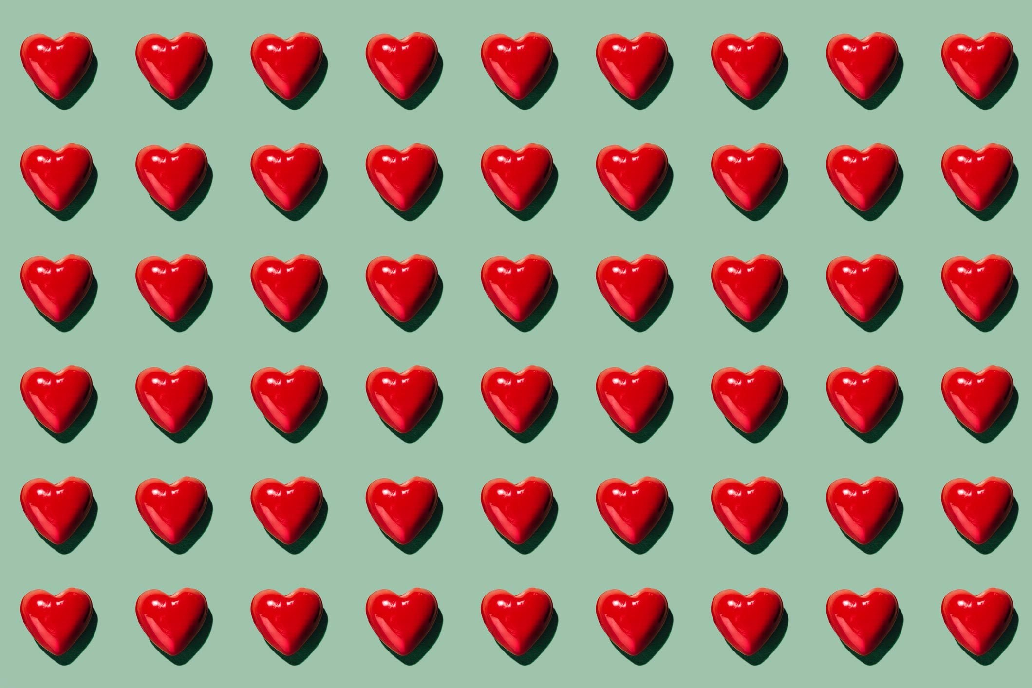 hearts pattern on green background