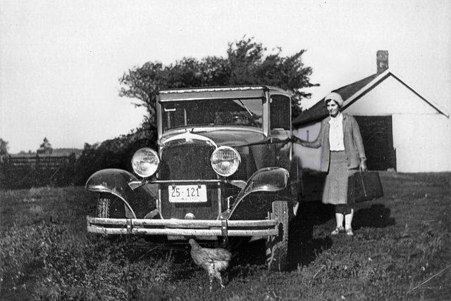 woman next to car