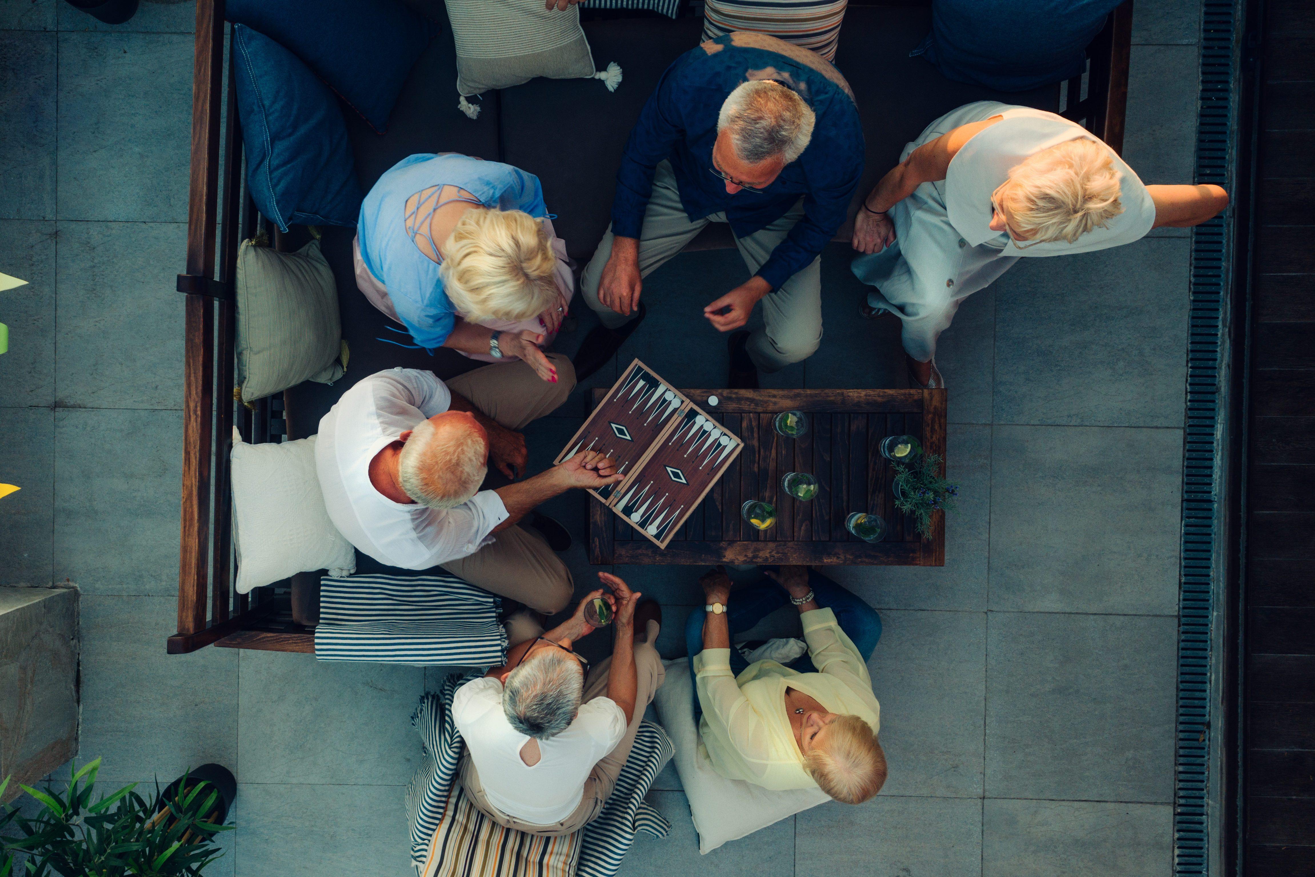 Senior Friends Playing Backgammon