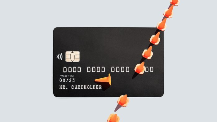 credit cards with traffic cones, one is knocked down. break the rules in an emergency concept.