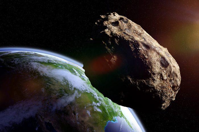asteroid approaching planet Earth, meteorite in orbit before impact
