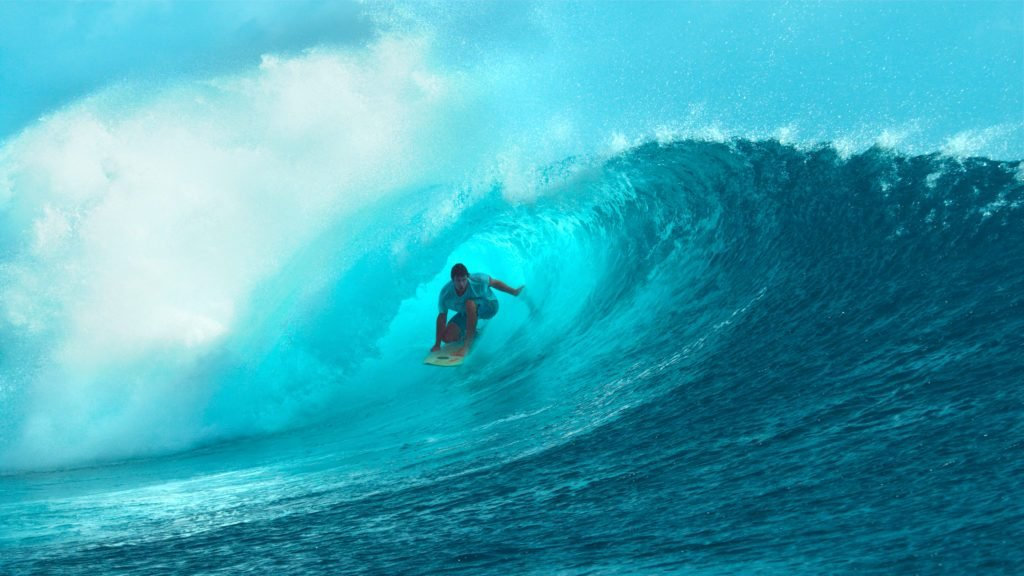 CLOSE UP: Fearless young surfboarder rides inside a spectacular barrel wave.