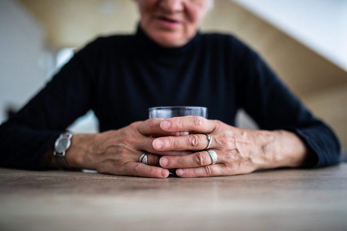 Senior Woman Having A Glass Of Whiskey